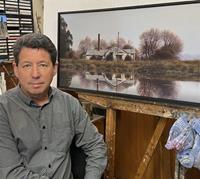 John Toomer in his home studio, Henley Co-op Cheese Factory on the easel.